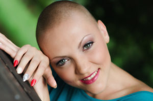Beautiful young bald woman - cancer survivor